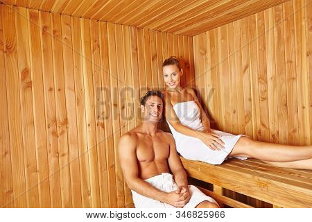 Young couple sweats together in the sauna of the hotel on vacation