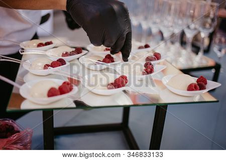 Fruit Tart With Raspberries And Cream, Cakes And Sweetness On Wedding. Hand Putting Berries In Desse