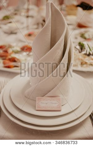 Banquet Table With Wedding And Festive Serving.table Covered With A Tablecloth And Served With Dishe