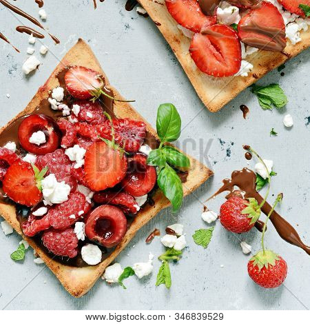 Toast With Strawberries, Raspberries, Cherries, Mint And Cottage Cheese For Breakfast. Healthy Break