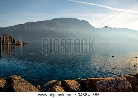 Riva Del Garda.lake Garda In Northern Italy. Melancholic And Romantic View Of The Lake At Sunset