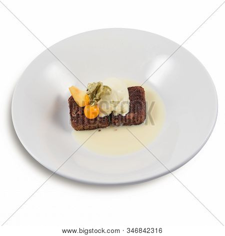 A Chocolate Walnut Brownies Dessert With Vanilla Icecream And Physalis