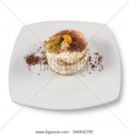 A Modern Dessert Of Creamy Tiramisu With Physalis.
