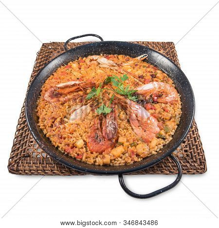 A Seafood Paella Dish On A White Background