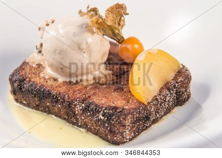 Detail Of A Spanish Style French Toast With Vanilla Ice Cream On A White Background