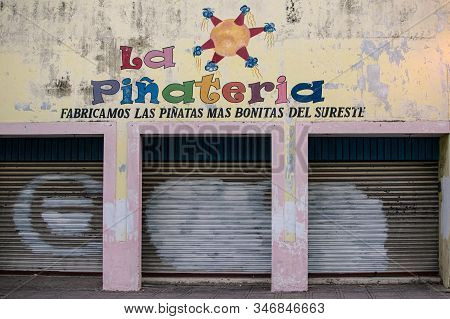 Brightly Painted Pinata Workshop In Merida, Mexico, February 2017. The Sign In Spanish Reads: