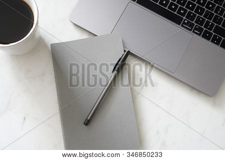View From Above Of A Closed Gray Notebook With A Pen, Laptop And A Mug Of Coffee; Modern; Minimal; W