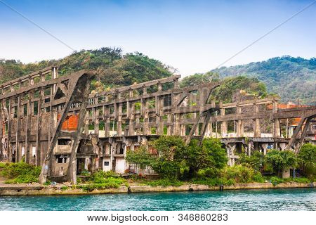 Keelung, Taiwan old ruins of a shipyard on the water.