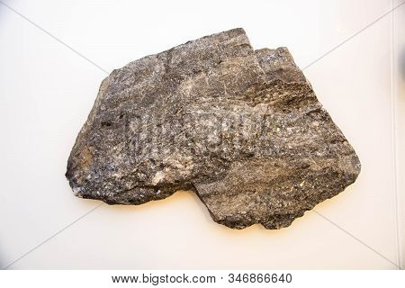 Antimonite Stone, Isolated On A White Background, Gray Color.