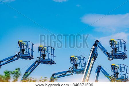 Articulated Boom Lift. Aerial Platform Lift. Telescopic Boom Lift Against Blue Sky. Mobile Construct