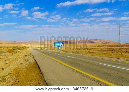 Negev, Israel - January 16, 2020: View Of Road 40, With A Traffic Safety Sign, In The Negev Desert,
