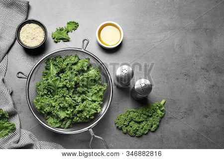 Raw Cabbage Leaves On Grey Table, Flat Lay. Preparing Kale Chips