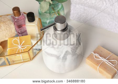 Marble Soap Dispenser And Toiletries On White Table