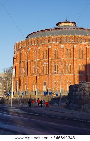 Stockholm, Sweden - January 18, 2020: Exterior View Of An Old Red Brick Gas Holder Building In The H