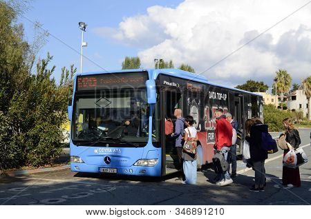 Central Bus Station Harbor. Paphos. Cyprus. January 21, 2020 - Bus To The Airport. People Get On The