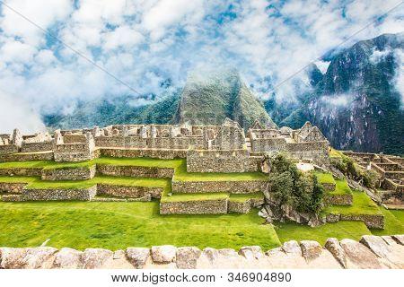 Machu Picchu Pueblo,  Peru - Jan 7, 2019:  Panoramic view on Ancient city of Machu Picchu in Peru. South America.