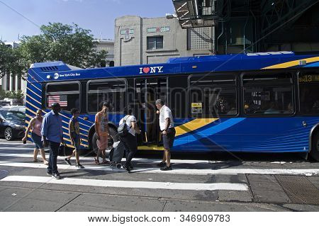 Bronx, New York/usa - July 3, 2019: Transit Worker Helps People Board Public Bus.
