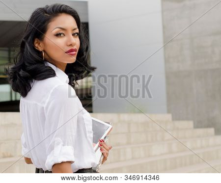 Woman walking to college or work