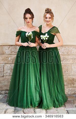 Two Beautiful Bridesmaids Girls Blonde And Brunette Ladies Wearing Elegant Full Length Off-the-shoul