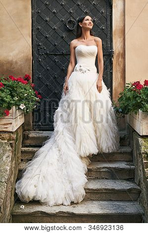 Beautiful Brunette Bride In Long White Corset Bodice Dress With White Puffy Gown And Chapel Train St