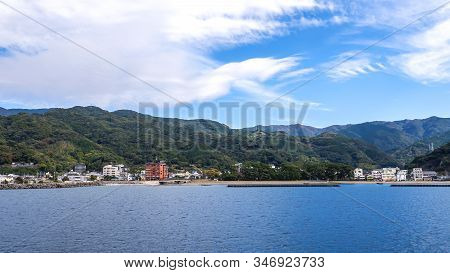 Landscape View Of Mountain Over Blue Sky And White Cloud From The Ferry Boat In The Ocean At Suruga