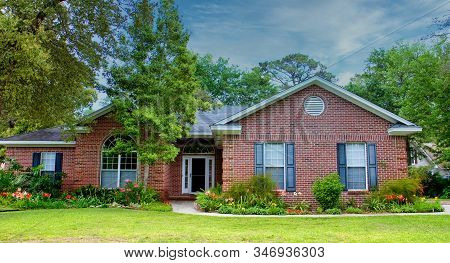 A Nice Brick House On A Hot Summer Southern Lawn