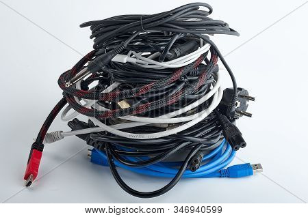Wires, Cables, Connecting Cords For Old Computers, Dusty, Used, Tangled In A Skein, Lie On A White B