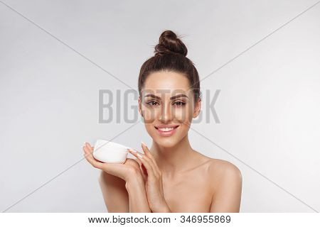 Hands Of A Woman About To Apply Face Cream. Holding Moisturizing Lotion.close-up Young Beautiful Fac
