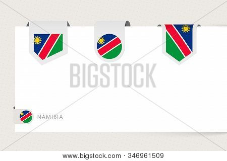 Label Flag Collection Of Namibia In Different Shape. Ribbon Flag Template Of Namibia Hanging From Pa
