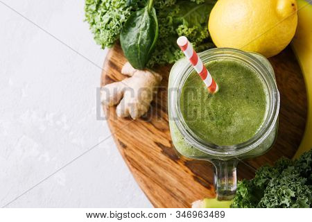 Freshly Prepared Jar Of Green Smoothie, Close Up. Fresh Vegetable Smoothie On A Light Background. Ve