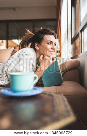 Beautiful Woman Reading A Book At Home.