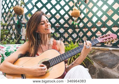 Beautiful Woman Playing Guitar Outdoors. Spanish Woman Playing Guitar . Playing Spanish Guitar. Life