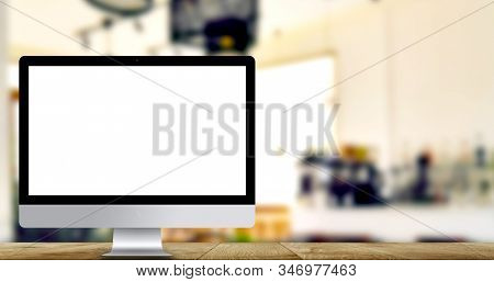 Pc Computer With Empty Screen On Wooden Table.background Blur Coffee Shop With Empty Copy Space.used