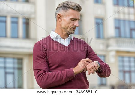 More Than Time-telling Device. Man Check Watch Urban Outdoors. Handsome Man Wear Wrist Watch. Using