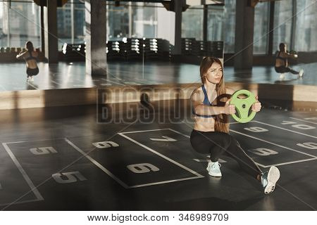Woman In Middle Of Functional Training In Gym. Attractive Caucasian Athletic Sportswoman Do Squats W
