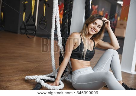 Joyful, Happy Healthy And Fit Blond Woman Sitting Gym Floor, Lean Functional Training Fitness Equipm