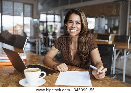 Business, Finance And Entrepreneur Concept. Happy Cheerful Attractive Spanish Woman Sitting Alone Ca