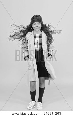 School Life. Fancy Schoolgirl. Girl Little Fashionable Pupil Wear Knitted Hat And Jacket. Modern Out