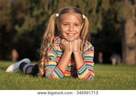 Cheerful Schoolgirl On Sunny Day. Girl Ponytails Hairstyle Enjoy Relax. Living Happy Life. Happy Smi
