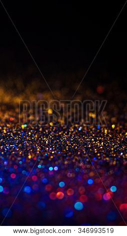 Multicolored Shining Glitter In Focus And Out Of Focus, Abstract Shiny Background. Multicolored Glit