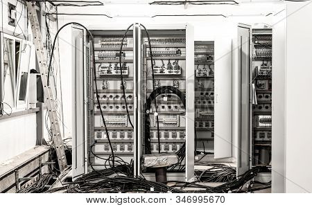 Relay Hall With A Variety Of Wires In The Process Of Installation
