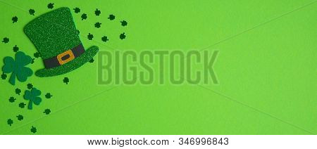 Happy St. Patrick's Day Concept. Top View Irish Elf Hat, Shamrock Leaf Clovers And Confetti On Green