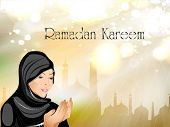 Ramadan Kareem or Ramazan Kareem background with Muslim girl in hijab reading Namaz and Mosque or Masjid illustration. EPS 10. poster