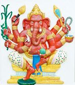 God of success 1 of 32 posture. Indian style or Hindu God Ganesha avatar image in stucco low relief technique with vivid colorWat Samarn ChachoengsaoThailand. poster