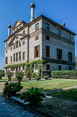 Villa Foscari nown as La Malcontenta is a patrician villa in Mira near Venice northern Italy designed by the Italian architect Andrea Palladio. poster