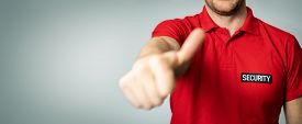 Security Service Guard In Red Uniform With Thumb Up On Gray Background. Copy Space