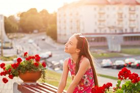 Portrait Of A Cute Teenager Girl Is Smiling And Having Fun Outdoors At Summer Evening