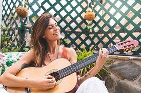 Beautiful Woman Playing Guitar Outdoors. Spanish Woman Playing Guitar . Playing Spanish Guitar. Life