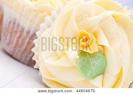 Homemade Creamy Luxury Cup Cakes With Detailed Flower And Sparkles