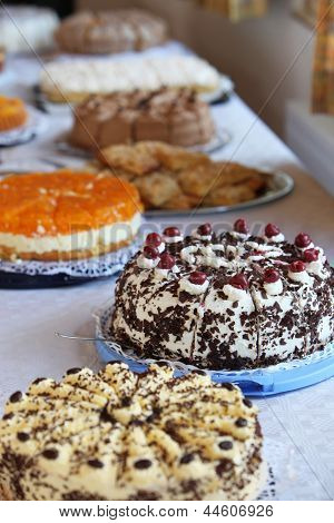 Buffet Table With An Assortment Of Cakes
